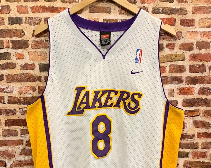 Featured listing image: Vintage Kobe Bryant #8 Los Angeles Lakers Men's Large Stitched Swingman Jersey made by Nike