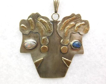 Gold and sterling Silver contemporary /folk art black opal lady heads pendant