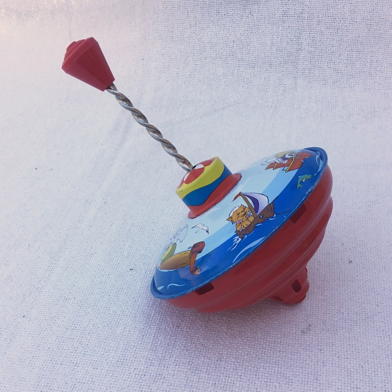 old fashioned spinning top toy Vintage toy planes boats raccoon elephant images Tin top Red blue animal /& transport motif spinner toy