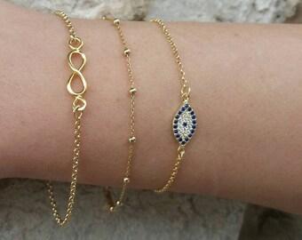 Layered Evil Eye, Infinity&Dew Drop Bracelets Set