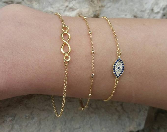 Layered bracelets, 14 Gold Filled Bracelets, Dew Drop Bracelet, Gold Evil Bracelet, Infinity Charm
