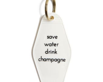 Save Water Drink Champagne Motel Keytag