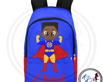 Back to school. African American boy superhero backpack. School supplies.  Backpacks. Books. Boys. Boy school supplies. Superhero. Little boy 958380633e977