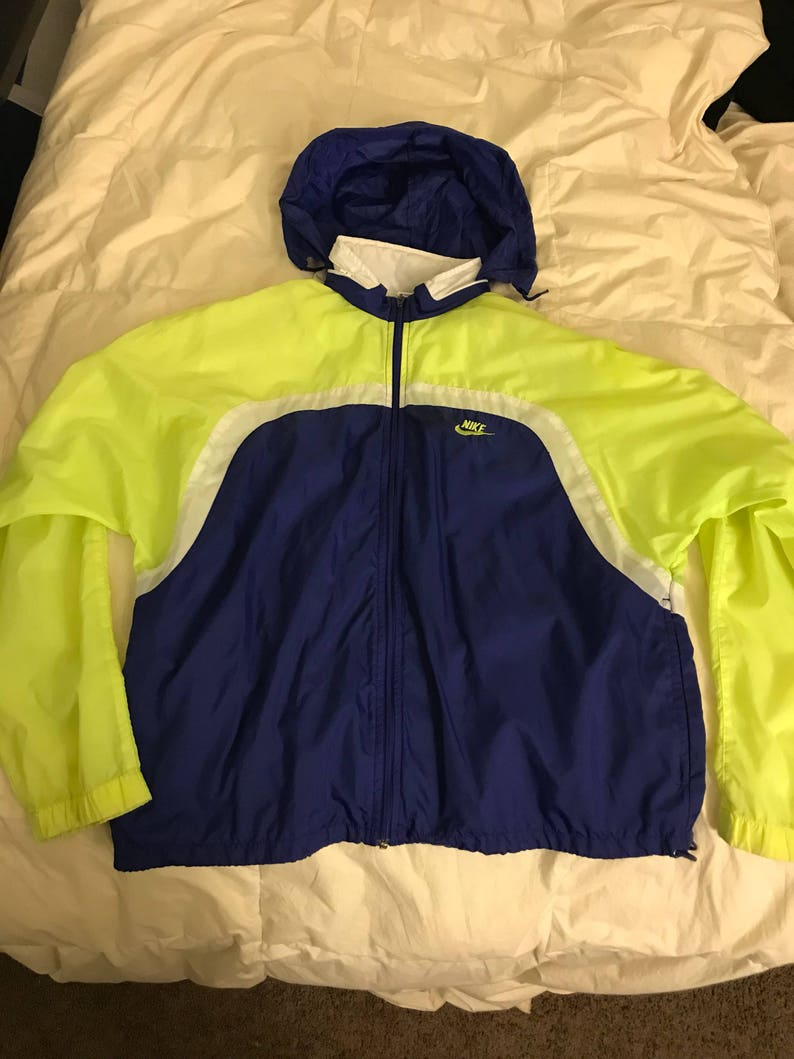 3a9d242dc Vintage Nike Grey Tag Windbreaker with Enclosed Hood Size Mens