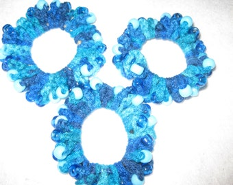 Crocheted multi-blue hairband with light blue and dark blue pony beads