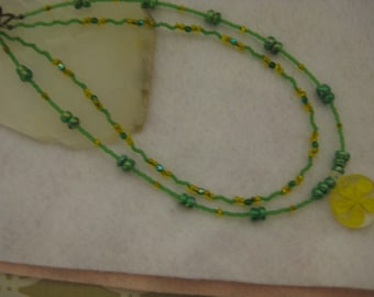 Sprintime necklace, seed beads green and yellow, green pearlescent beads, yellow floral pendant