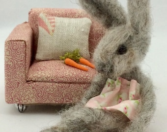 Needle felted bunny in chair.