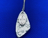 Miraculous medal with cla...