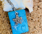 Blue clay starfish neckla...