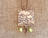 Embossed metal necklace...