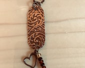 Embossed copper pendant n...