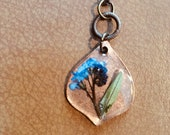 Brass and blue flower res...