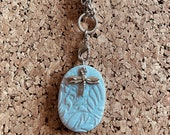 Stamped clay necklace wit...