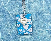 Silver hearts blue clay n...