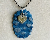 Scalloped-edge blue oval ...
