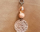 Embossed copper necklace...