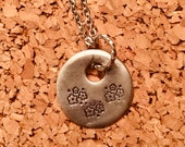 Flower stamped metal neck...
