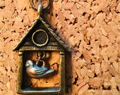 Brass birdhouse necklace ...