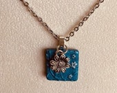 Blue flower stamped clay ...