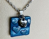 Square blue stamped clay ...