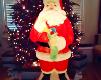 40 tall blow mold santa claus holding green stocking of toys vintage 1960s yard decoration