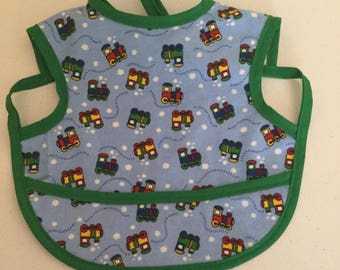 Green train baby bib with front pocket