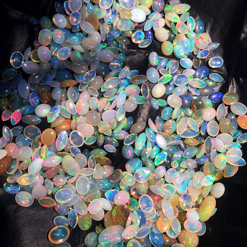 AAA Quality Natural Ethiopian Opal Cabochons Flash Ethiopian Opal Cabochons EO-4FGS79 10x13x7 mm