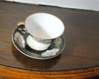 Ucagco China Hand Painted Made in Japan Colorful BlackTeacup and Saucer Trimmed in Gold