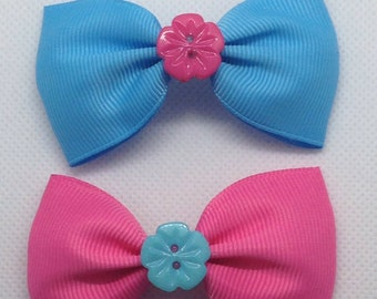 Pair of bright Blue and Pink bow crocodile hair Clips.