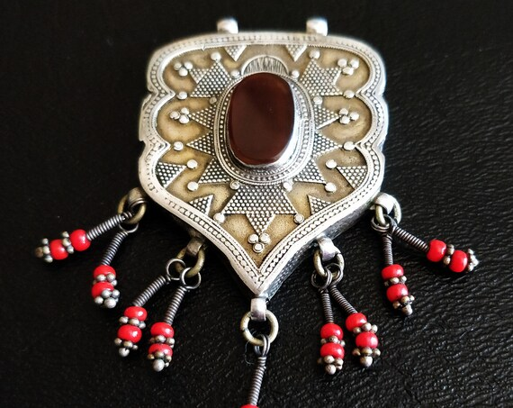 TURKOMAN STERLING PENDANT Antique Ersary Turkoman Silver Pendant Repousse Gold-wash focal carnelian and small coral dangles  double bails