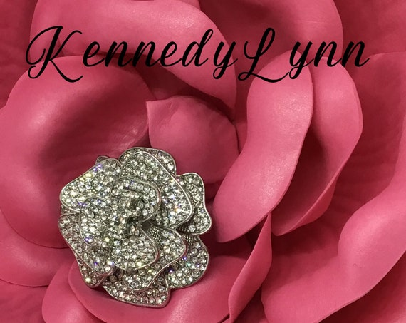 Crystal Rose Brooch with Jack and Jill logo