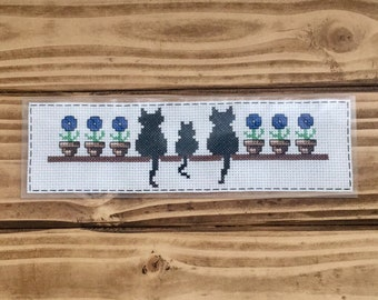 Cat bookmark with blue flowers cross stitch