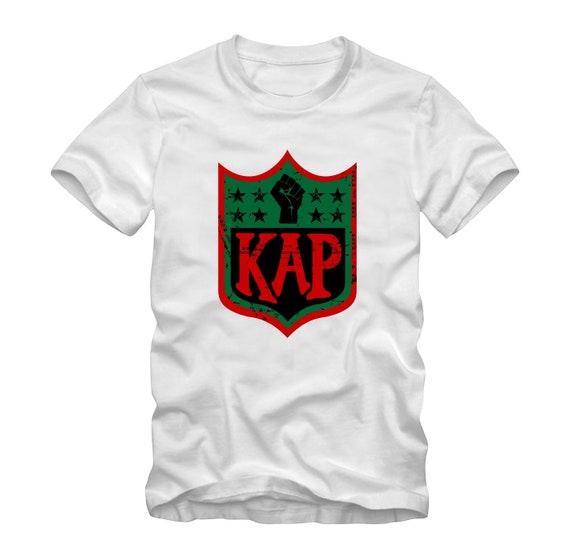 ce9c24813 Colin Kaepernick Kap RBG NFL shield Inspired shirt White