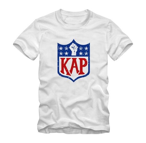 d7dc77792 Colin Kaepernick Kap NFL shield Inspired shirt White