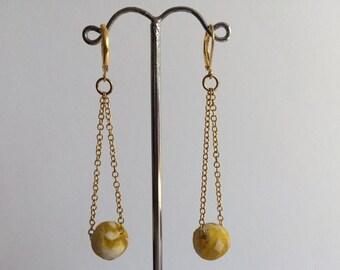 Chain and yellow glass bead earrings