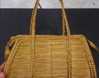 Weaved hand crafted handbag from Vegetative Gold