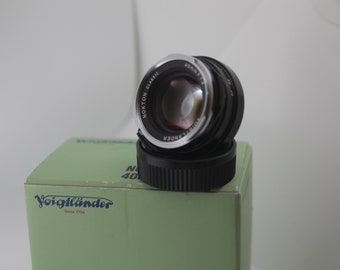 Voigtlander 40mm f1.4 SC Classic M Mount with hood and UV filter.