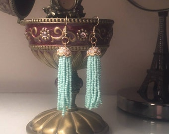 Turquoise Tassle Earrings with Gold Detailing