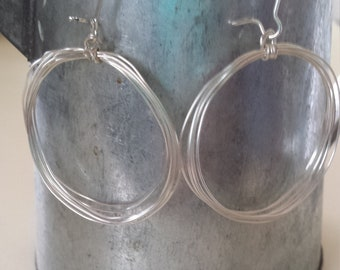 Many Silver Colored Hooped Dangle Earrings