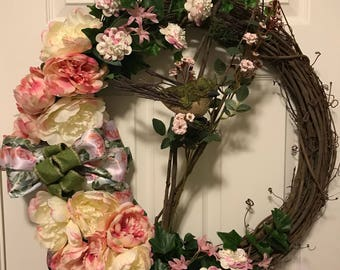 Spring flowers with bird in twig nest wreath