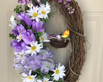 Oval wreath with bird and hanging nest