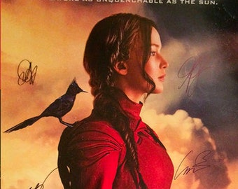 The hunger games mockingjay movie poster signed by cast