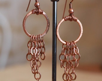 Copper hoop style earrings