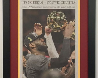89f9f2e55e4 Cleveland Cavaliers   LeBron James - 2016 NBA Champions - Cleveland Plain  Dealer Newspaper - Double Matted   Framed (Official Team Colors)