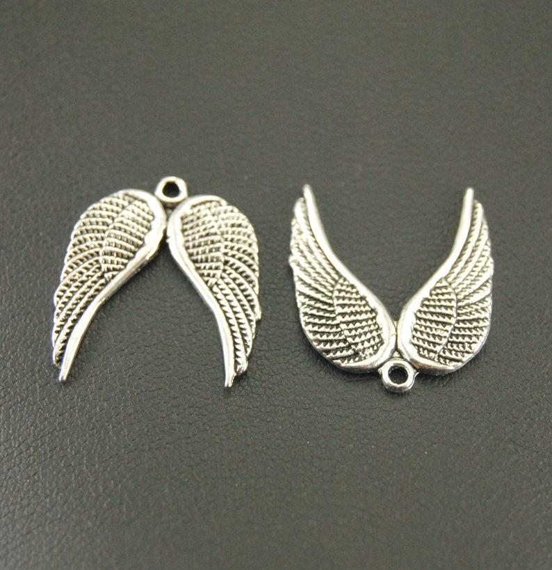 BULK 50 Feather charms antique silver tone B181