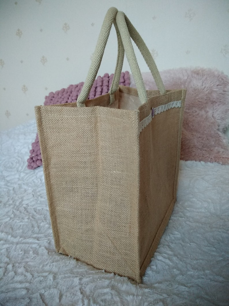 Tote bag in Burlap with lace and flower Medallion trim.