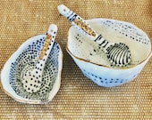Two Handmade and painted black and white porcelain condiment dishes and spoon with real gold