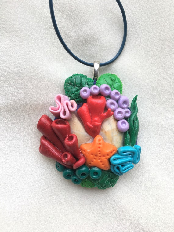 Sponge Coral with polmer and leather pendant