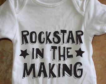 d6e11d071 Rockstar baby onesie