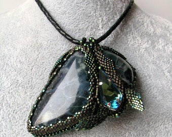 "Pendant necklace ""Green noise"" with ophite (serpentine) and Swarovski crystal on a leather cord"
